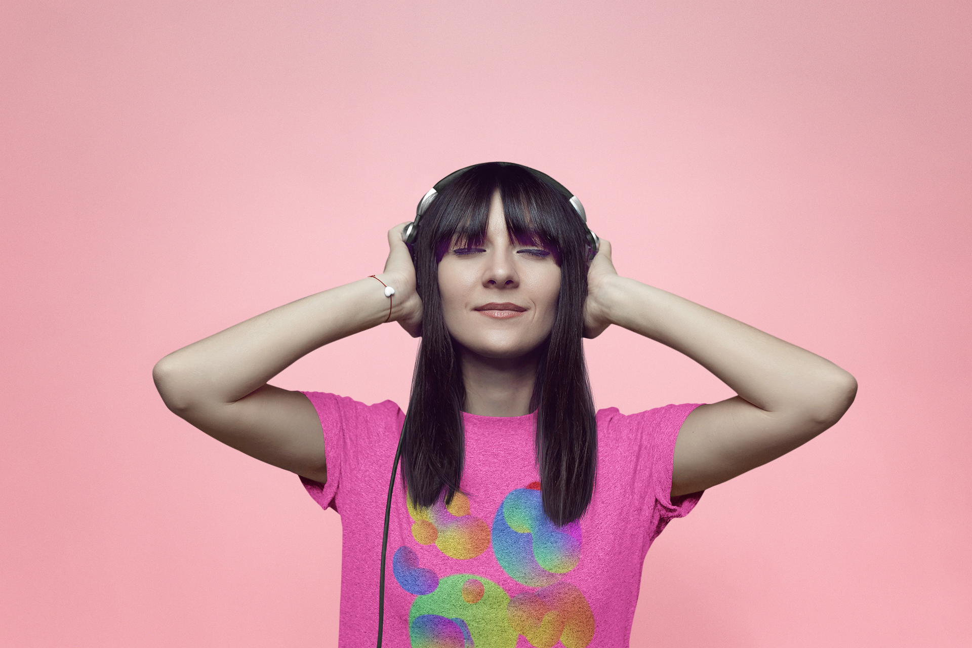heathered-tee-mockup-of-a-woman-listening-to-music-at-a-studio-37027-r-el2